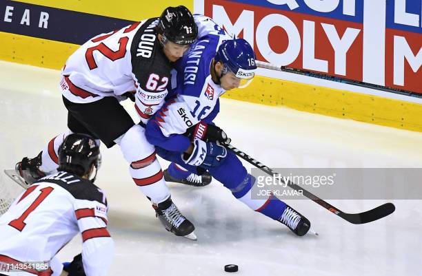 Canada's defender Brandon Montour and Slovakia's forward Robert Lantosi vie for the puck during the IIHF Men's Ice Hockey World Championships Group A...