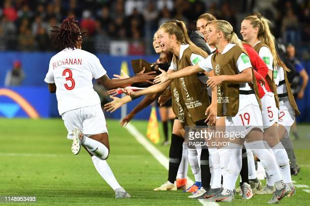 TOPSHOT Canada's defender Kadeisha Buchanan celebrates with teammates after scoring the opening goal during the France 2019 Women's World Cup Group E...