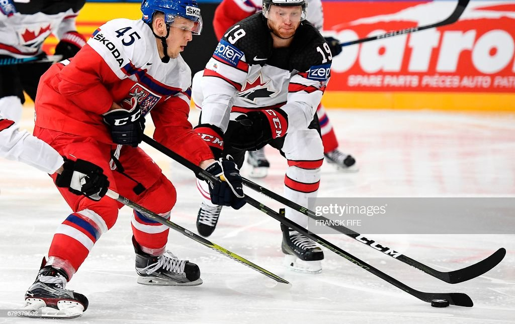 Canada's defender Mike Matheson (R) challenges Czech Republic's defender Radim Simek during the IIHF Men's World Championship group B ice hockey match between the Czech Republic and Canada in Paris on May 5, 2017. /