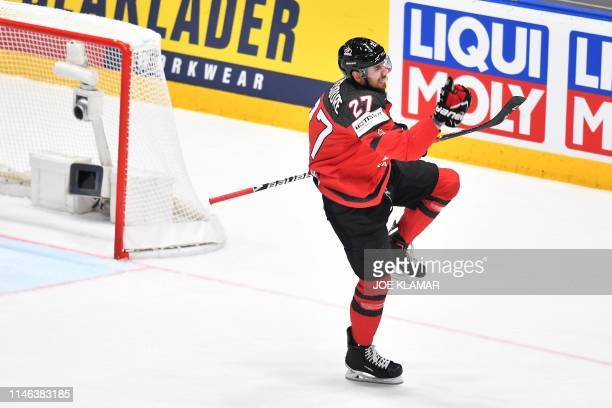 Canada's defender Shea Theodore celebrates scoring the opening goal during the IIHF Men's Ice Hockey World Championships final between Canada and...