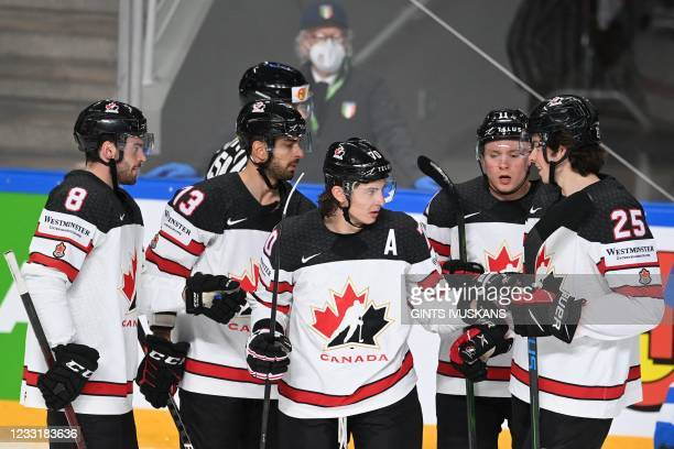 Canada's defender Troy Stecher is celebrated by teammates after scoring the 0-3 during the IIHF Men's Ice Hockey World Championships preliminary...