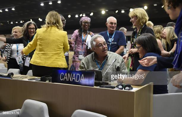 Canadas delegation members to the United Nations Educational Scientific and Cultural Organisation are seen celebrating after Canadas Pimachiowin Aki...