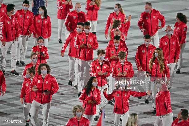 Canada's delegation parade during the opening ceremony of the Tokyo 2020 Olympic Games, at the Olympic Stadium, in Tokyo, on July 23, 2021.