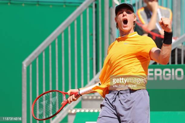 Canada's Denis Shapovalov celebrates after scoring a point against Germany's Jan-Lennard Struff during their tennis match on the day 3 of the...