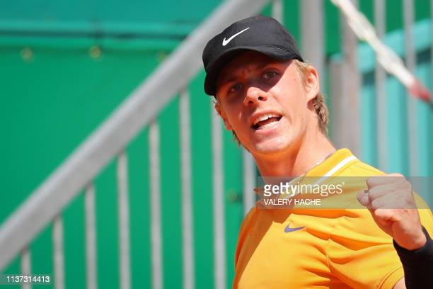Canada's Denis Shapovalov celebrates after scoring a point against Germany's JanLennard Struff during their tennis match on the day 3 of the...