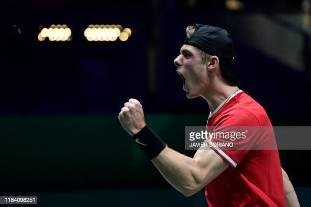 Canada's Denis Shapovalov celebrates after winning a point against Russia's Karen Khachanov during the semi-final singles tennis match between Russia...