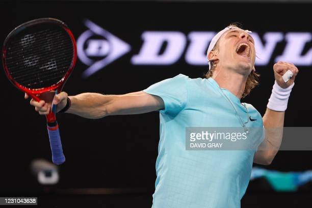 Canada's Denis Shapovalov celebrates beating Italy's Jannik Sinner during their men's singles match on day one of the Australian Open tennis...