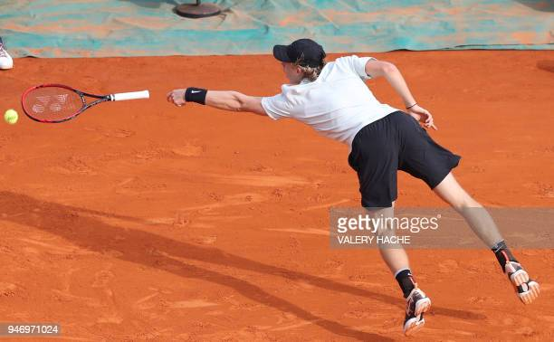 Canada's Denis Shapovalov drops his racket as he plays a return to Greece's Stefanos Tsitsipas during their round of 64 tennis match at the...