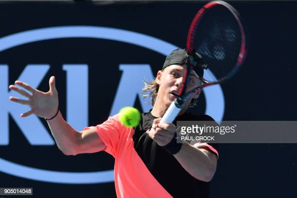 Canada's Denis Shapovalov hits a return against Greece's Stefanos Tsitsipas during their men's singles first round match on day one of the Australian...