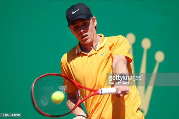 Canada's Denis Shapovalov plays a backhand return to Germany's JanLennard Struff during their tennis match on the day 3 of the MonteCarlo ATP Masters...