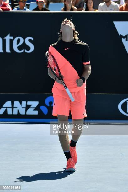 Canada's Denis Shapovalov reacts after a point against Greece's Stefanos Tsitsipas during their men's singles first round match on day one of the...