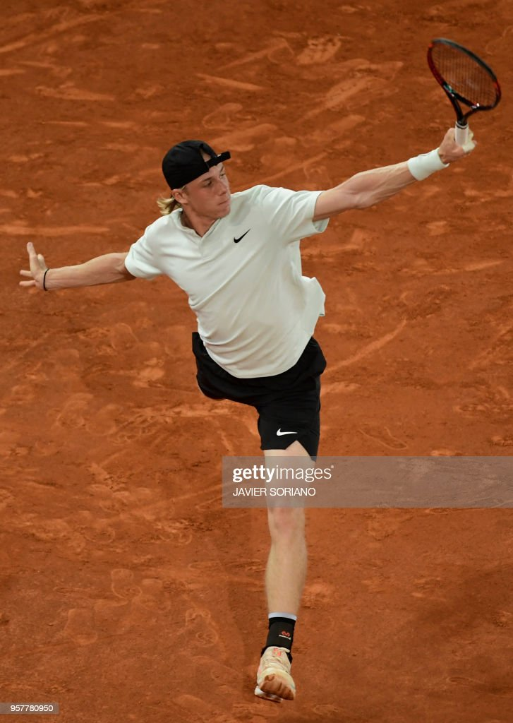 Canada's Denis Shapovalov returns the ball to Germany's Alexander Zverev during their ATP Madrid Open semi-final tennis match at the Caja Magica in Madrid on May 12, 2018.