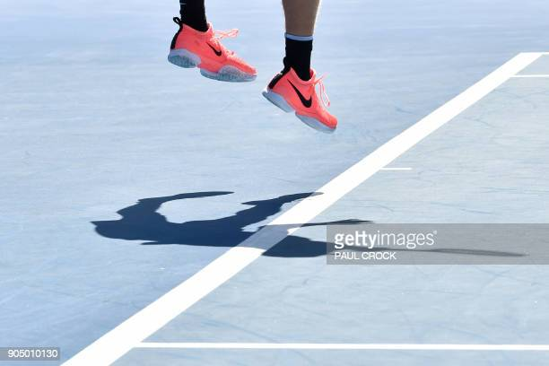 Canada's Denis Shapovalov serves against Greece's Stefanos Tsitsipas during their men's singles first round match on day one of the Australian Open...