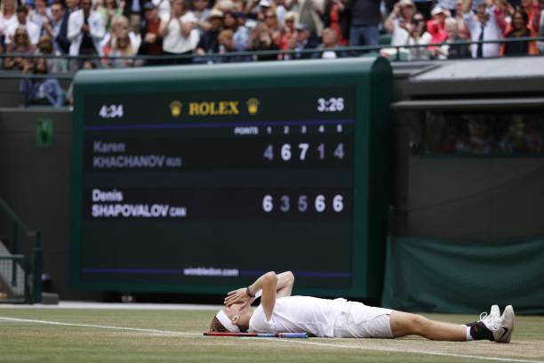 Canada's Denis Shapovalov wins match point against Russia's Karen Khachanov during their men's quarter-finals match on the ninth day of the 2021...