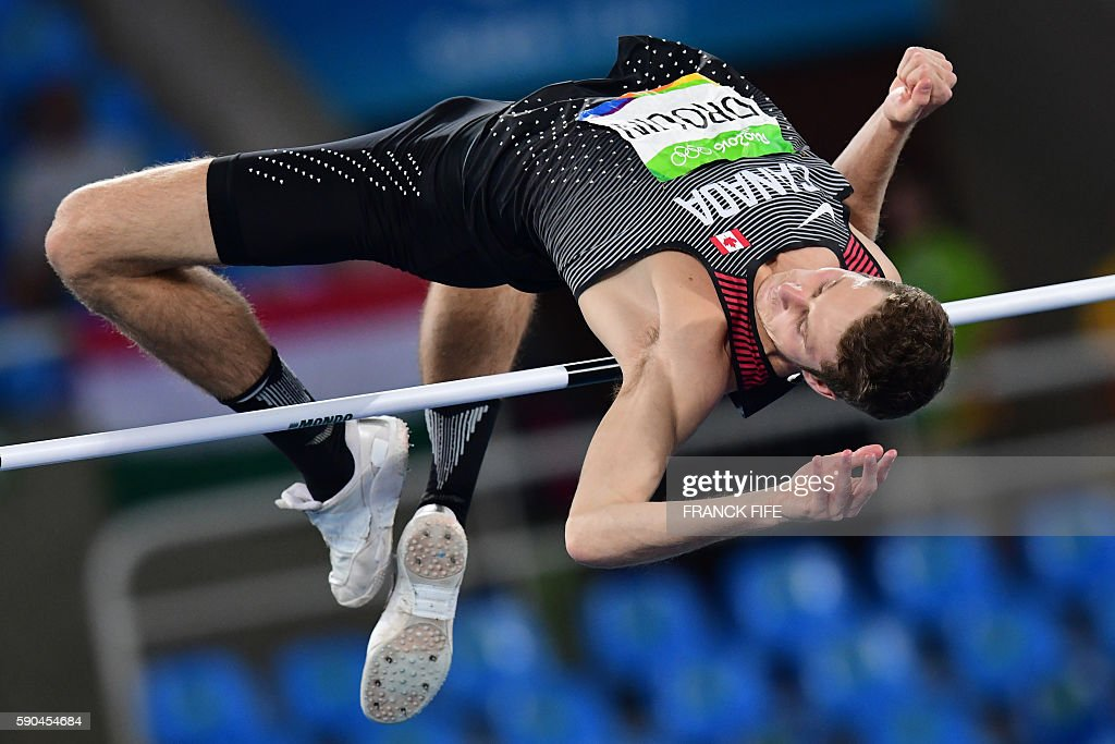 TOPSHOT - Canada's Derek Drouin competes in the Men's High Jump Final during the athletics event at the Rio 2016 Olympic Games at the Olympic Stadium in Rio de Janeiro on August 16, 2016. / AFP / FRANCK