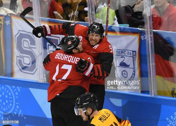 TOPSHOT Canada's Derek Roy celebrates scoring a goal in the men's semifinal ice hockey match between Canada and Germany during the Pyeongchang 2018...