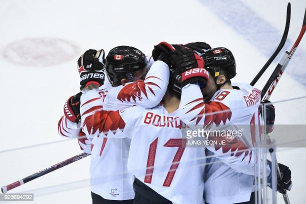 Canada's Derek Roy is congratulated by teammates after scoring in the men's bronze medal ice hockey match between the Czech Republic and Canada...