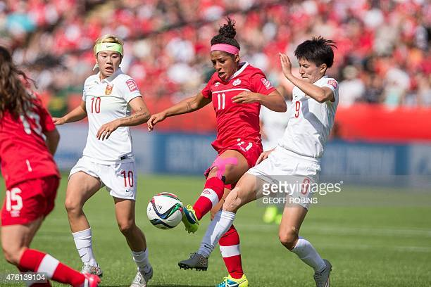 Canada's Desiree Scott vies with China's Wang Shanshan and Li Ying during a Group A football match between Canada and China at Commonwealth Stadium...