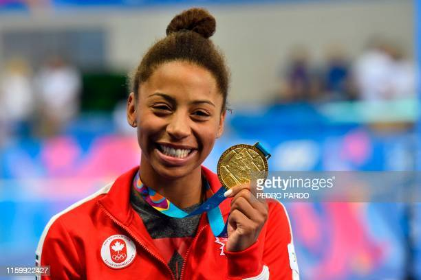 Canada's diver Jennifer Abel celebrates on the podium with her gold medal after winning the Diving Women's 3m Springboard Final of the Lima 2019...