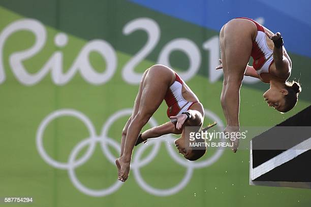 Canada's duet Meaghan Benfeito and Roseline Filion compete in the Women's Synchronised 10m Platform Final during the diving event at the Rio 2016...