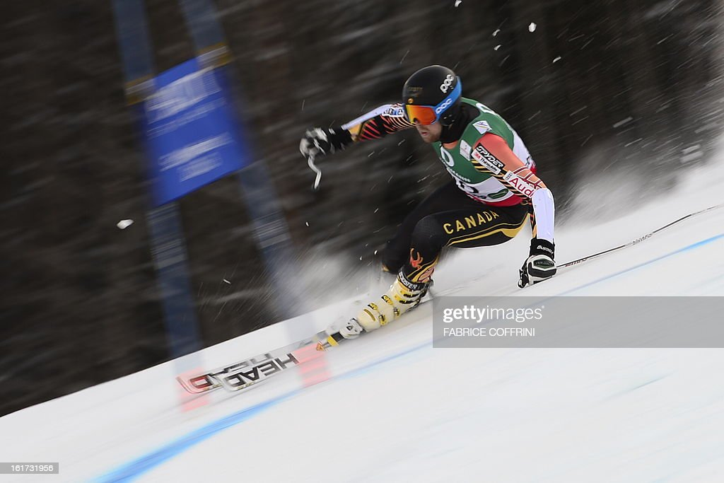 Canada's Dustin Cook skis during the first run of the men's Giant slalom at the 2013 Ski World Championships in Schladming, Austria on February 15, 2013.