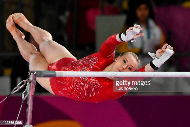 Canada's Elsabeth Ann Black makes her routine during the Artistic Gymnastics Women's Uneven Bars Final during the Lima 2019 Pan-American Games in...