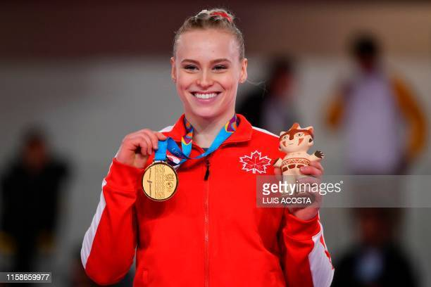 Canada's Elsabeth Ann Black poses on the podium with her gold medal after winning the Artistic Gymnastics Women's Vault Final during the Lima 2019...