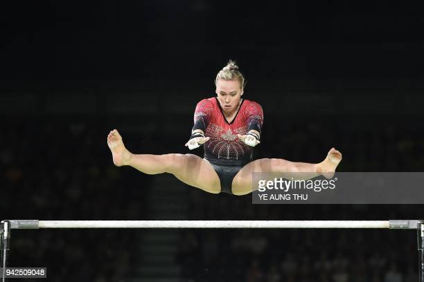 Canada's Elsabeth Black competes on the uneven bars during the women's team final and individual qualification in the artistic gymnastics event...