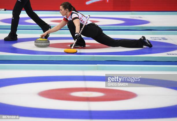 Canada's Emma Miskew releases the stone during the gold medal match against Russia at the Women's Curling World Championships in Beijing on March 26...