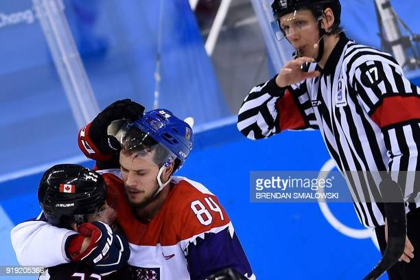 Canada's Eric O'Dell and Czech Republic's Tomas Kundratek fight during overtime of the men's preliminary round ice hockey match between Canada and...
