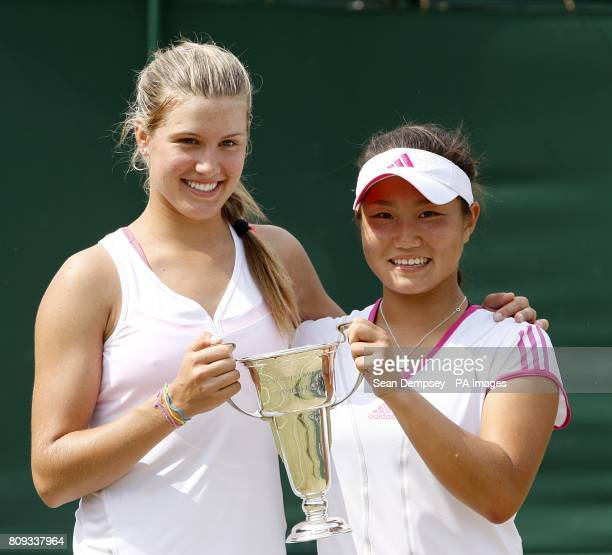 Canada's Eugenie Bouchard and USA's Grace Min pose with the trophy after winning the Girls' Doubles on day thirteen of the 2011 Wimbledon...