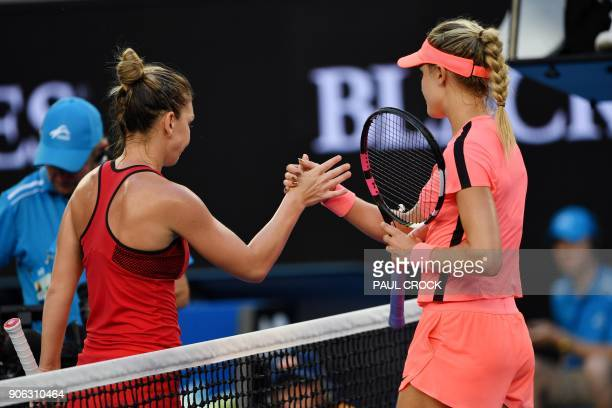 Canada's Eugenie Bouchard congratulates Romania's Simona Halep after their women's singles second round match on day four of the Australian Open...