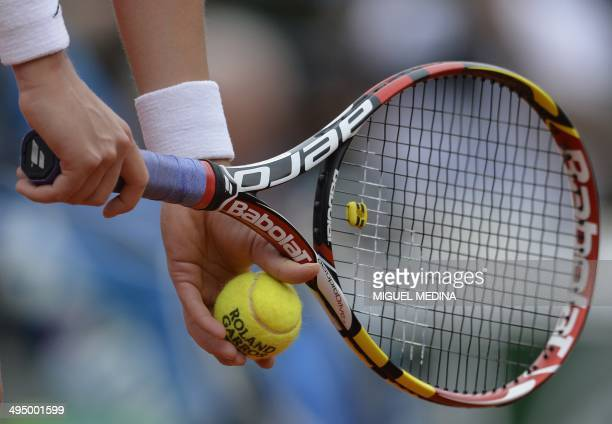 Canada's Eugenie Bouchard gest ready to serve to Germany's Angelique Kerber during their French tennis Open round of sixteen match at the Roland...