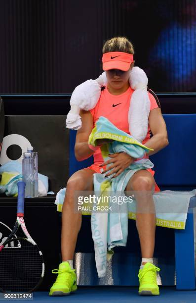 Canada's Eugenie Bouchard hits a return against Romania's Simona Halep during their women's singles second round match on day four of the Australian...