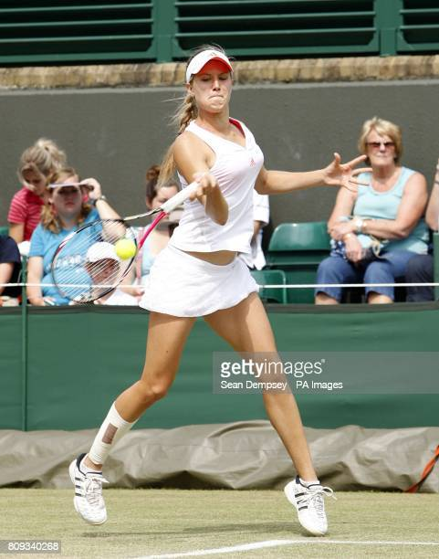 Canada's Eugenie Bouchard in action in the Girls' Doubles final playing with USA's Grace Min on day thirteen of the 2011 Wimbledon Championships at...
