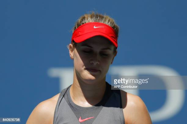 Canada's Eugenie Bouchard reacts after losing a point against Russia's Evgeniya Rodina during their 2017 US Open Women's Singles match at the USTA...