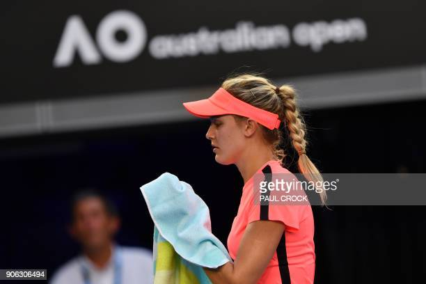Canada's Eugenie Bouchard reacts during their women's singles second round match against Romania's Simona Halep on day four of the Australian Open...
