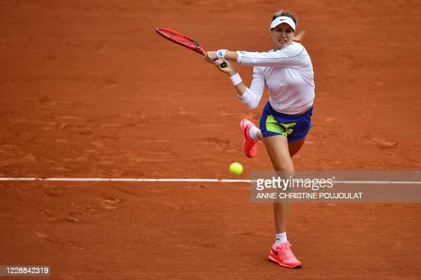 Canada's Eugenie Bouchard returns the ball to Poland's Iga Swiatek during their women's singles third round tennis match on Day 6 of The Roland...