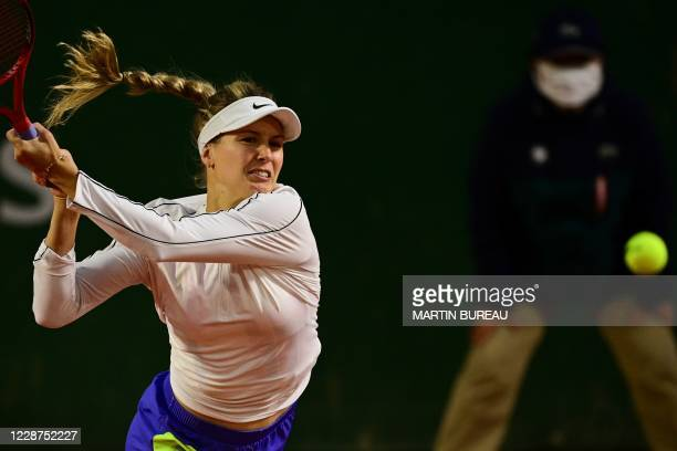 Canada's Eugenie Bouchard returns the ball to Russia's Anna Kalinskaya during their women's singles first round tennis match on Day 1 of The Roland...