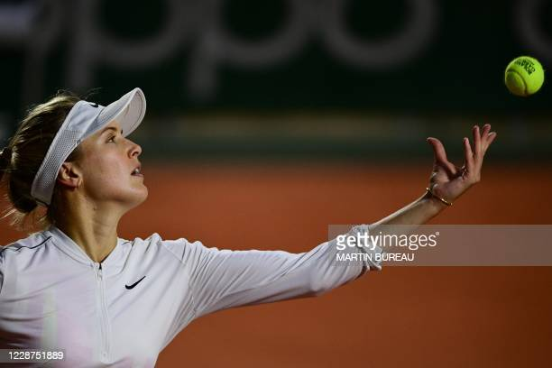 Canada's Eugenie Bouchard serves the ball to Russia's Anna Kalinskaya during their women's singles first round tennis match on Day 1 of The Roland...