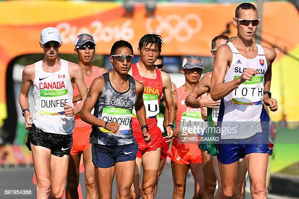 Canada's Evan Dunfee Ecuador's Andres Chocho China's Yu Wei and Slovakia's Matej Toth compete in the Men's 50km Race Walk during the athletics event...