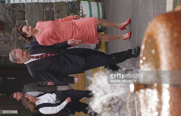 Canada's federal leader and Prime Minister Jean Chretien and his wife Aline walk out of the hotel of Grand-Mere, Canada, after having made a special...