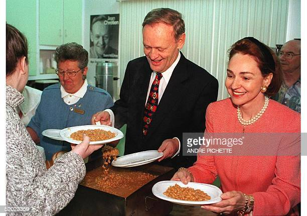 Canada's federal leader and Prime Minister Jean Chretien and his wife Aline serve plates of beans during his last rally campaign 01 June at...