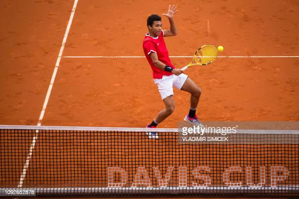 TOPSHOT Canada's Felix Auger Aliassime returns the ball during the Davis Cup qualifiers double tennis match Slovakia vs Canada in Bratislava on...