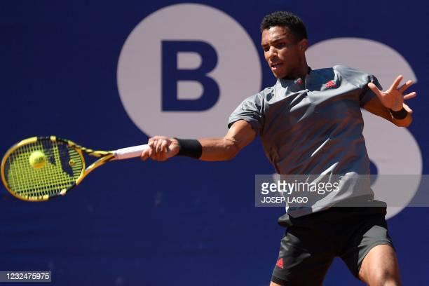 Canada's Felix Auger Aliassime returns the ball to Greece's Stefanos Tsitsipas during their ATP Barcelona Open tennis tournament singles...