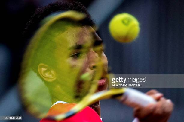 Canada's Felix Auger Aliassime returns the ball to Slovakia's Martin Klizan during the men's singles match in the Davis Cup 2019 tennis qualifier...