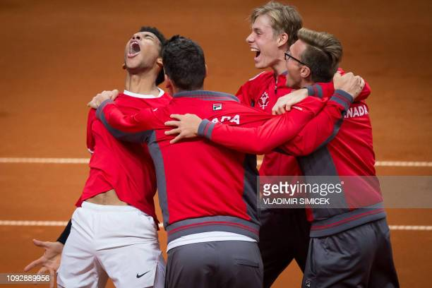 Canada's Felix AugerAliassime and Canadian team celebrate his victory against Slovakia's Norbert Gombos during the men's singles match in the Davis...