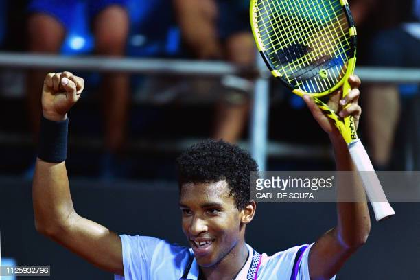 Canada's Felix AugerAliassime celebrates after beating Italy's Fabio Fognini during their ATP World Tour Rio Open singles match at the Jockey Club in...