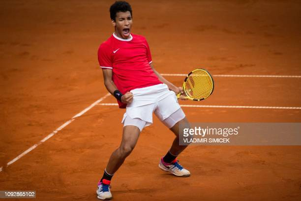 TOPSHOT Canada's Felix AugerAliassime celebrates his victory against Slovakia's Norbert Gombos during the Davis Cup qualifiers tennis match Slovakia...