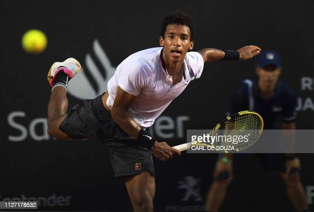 Canada's Felix AugerAliassime hits the ball against Serbia's Laslo Djere during the ATP World Tour Rio Open singles final match at the Jockey Club in...